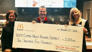 Shown from left to right are Comox Valley McDonald's owners Jess and Stuart Aldred, presenting funds to Robyn Butler, CVRD's marketing specialist.